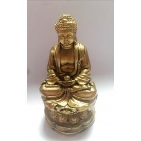 Bouddha doré assis sur un...